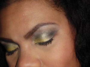 grey and yellow makeup look
