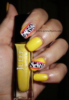 A zebra nail designs for my MANICure Monday feature. Using Yellow, black, white, and pink nail polish to achieve the look. www.growitgirl.com