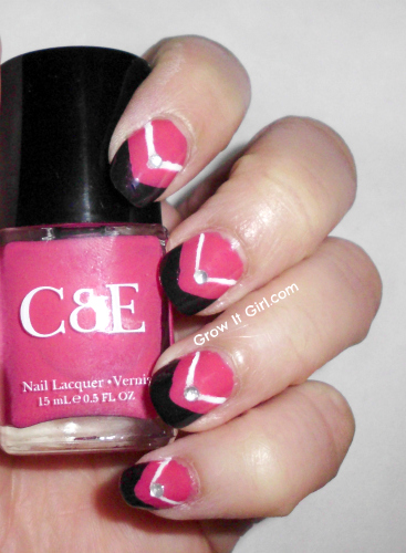 Hand holding the Crabtree Raspberry Nail Lacquer bottle
