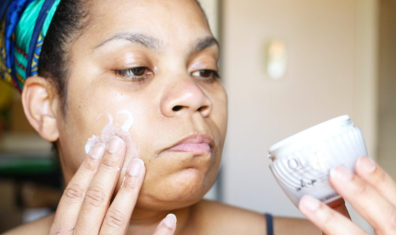 Applying Olay Whips Luminous with SPF 25